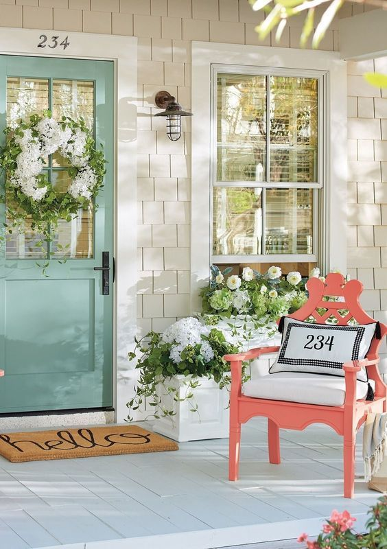 Love The Color Pops On This Spring Front Porch A Light Turquoise Wooden Door Is Decorated With A Wh Spring Porch Decor Front Porch Decorating Porch Decorating