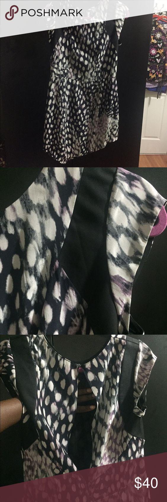 Midi dress MIDI dress with asymmetric bottom and see through back. Very unusual and cute. Neiman Marcus Dresses Midi