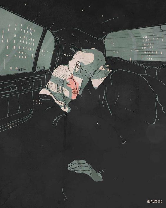 Casal se beijando dentro do carro.