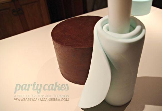 Great tutorial and pictures on - How to cover double barrel cake