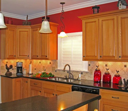 beige tile back splash goes nicely with red accents  Kitchen Ideas