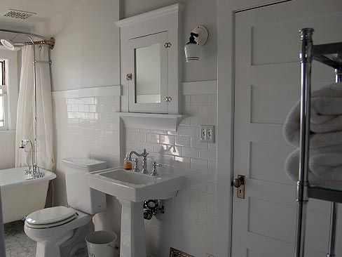 bungalow 1912 - whhhhiiittteee. marble floors, subway tile. she also has a round up of where she got all the fixtures etc. built ins...yes please. she also mentioned that she would do grey grout instead of white. good tip.