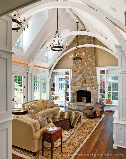 Wide open living room ceiling. Love it. If the fireplace was where the couches were facing and the kitchen was were the fireplace is, it would be perfect.