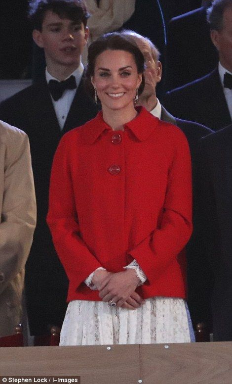 The Duchess of Cambridge wore a white dress and kept warm from the chilly night by layering a red cape coat over the top: