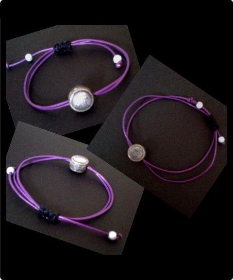 Purple leather wristband with silver grey polymer bead. Black waxed cotton thread is used to create a slip knot adjustable sizing with silver acrylic beads on the end.