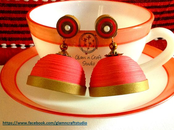 Quilled Jhumkas made using quilling strips in pink shade with a golden