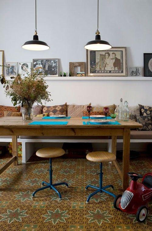 bench, dining table, stools, lights, shelf, art