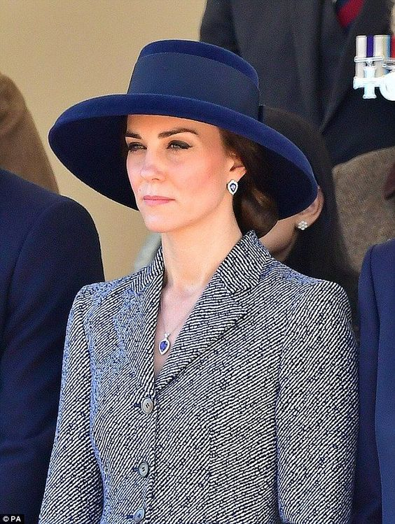 The Duchess accessorised witth a matching pear-shaped tanzanite and diamond necklace and earrings by G. Collins & Sons: