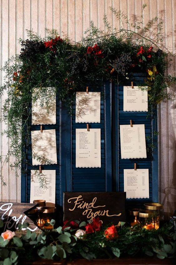 Rustic wedding seating chart made from shudders
