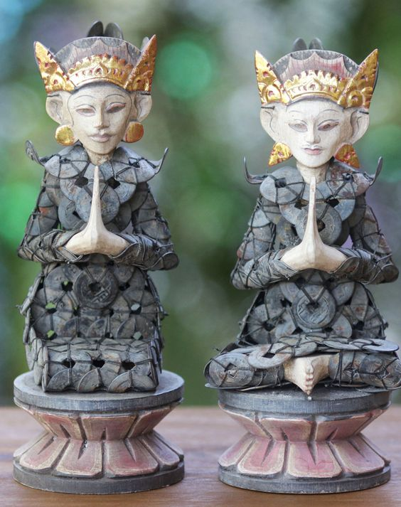 Sitting on lotus thrones, a couple is dressed in pis bolong coins for their Hindu nuptials. Brought to Bali from China, the pis bolong is now used in many Hindu ceremonies as they are believed to bring good luck.