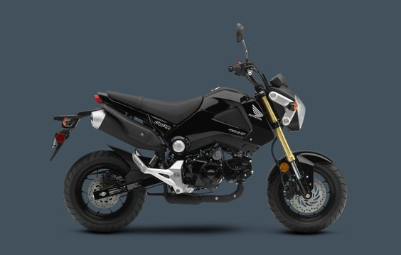 2014 Grom Metallic Black. i want a green one. and women riders in the ads, honda. check your demographics