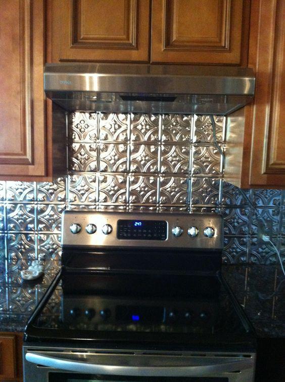 Black countertops tins and the cabinet on pinterest for Black tin backsplash
