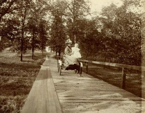 Mrs. A.L. Dyke and daughter Frances touring Forest Park in a French-built, 1900 DeDion Quadricycle.