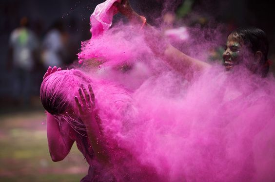 Indians throw colored powder during Holi festival celebrations in Hyderabad, India, Wednesday, March 27, 2013. (AP Photo/Mahesh Kumar A.)