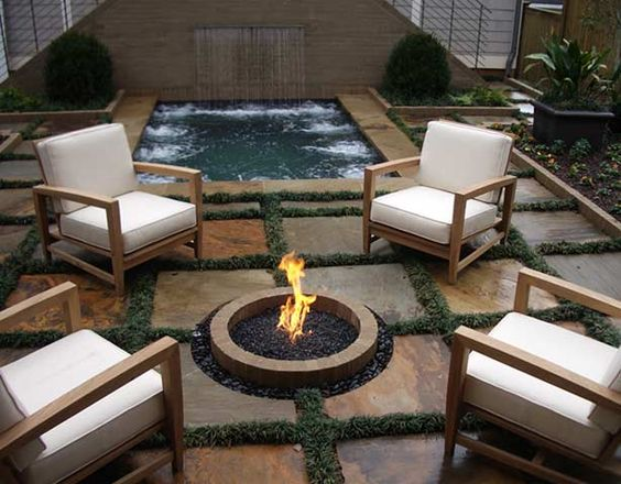 Fire Place Flush With Floor By The Pool And Waterfall