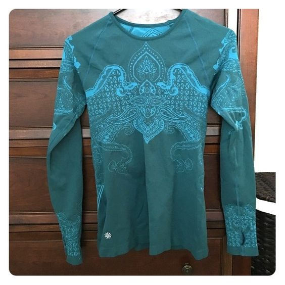 Athleta teal long sleeved running top. Beautiful rarely worn Athleta patterned running/workout too. Long sleeved with thumb holes. Athleta Tops Tees - Long Sleeve