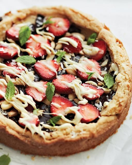 Chocolate, Strawberry, & Macadamia Dessert Pizza with a Sugar Cookie Crust recipe from @SweetPaul