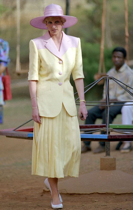 Mirror Online:  Vision in yellow: Princess of Wales during a trip to Nigeria and Cameroon in March 1990