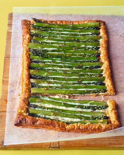 Could this be any easier? Roll out puff pastry dough, bake 15 minutes at 400. Sprinkle with Gruyere (or cheese of your choice) and top with Asparagus. Brush with oil, top with salt and pepper. Bake another 20-25 minutes. --Martha Stewart Recipes...