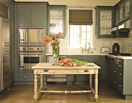 painted cabinets. stainless steel appliances. vintage table island...sweeet!
