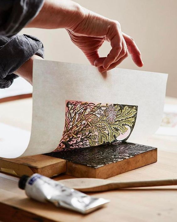 Angie Lewin hand burnishing her wood engraving 'Sea Pinks'
