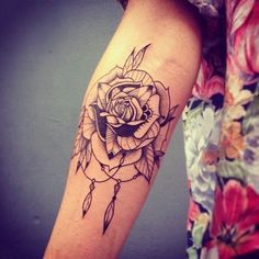 Nice floral tattoo. I especially like the dream catcher feathers and rings on the bottom