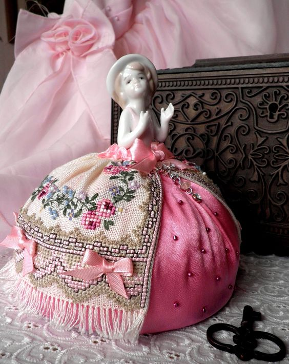 Pretty pincushion doll with a cross stitch skirt