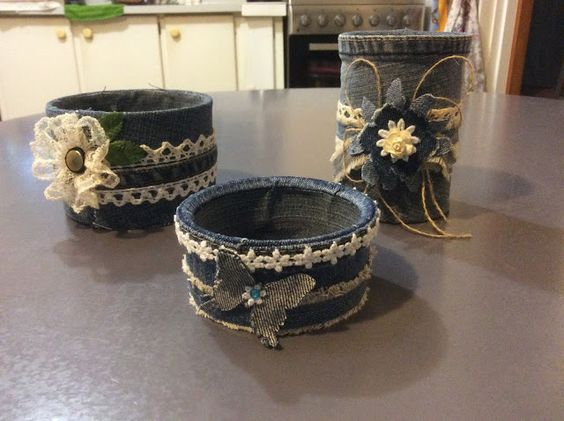 Old tin cans are never the same after being covered with fabric from recycled denim jeans