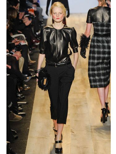 Leather  Michael Kors  Another case of mixing the conservative with the ultra-liberal: This chic leather top ups the ante on this otherwise demure combination of black capris and Mary Janes. #FallFashion #Trends #Fashion
