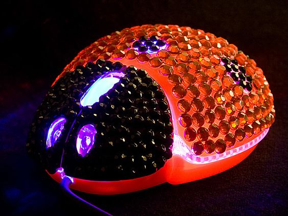 Blinged out Ladybug mouse. Looks cool, but I don't know how comfortable it would be to use.