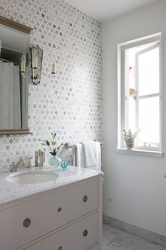 Repurposed antique dresser as vanity in Sarah Richardson classic vintage style bathroom in London Flat. #bathroom #mosaictile #aqua #cottagestyle