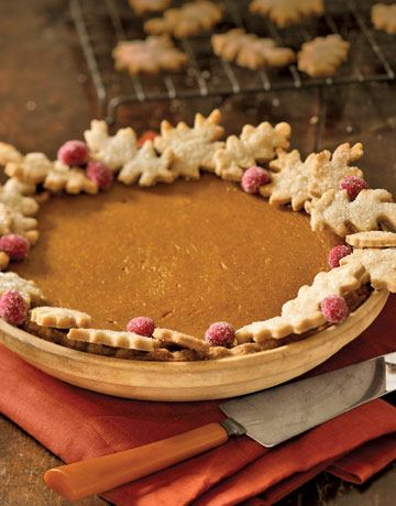 Classic Pumpkin Pie  Pastry oak leaves look pretty and hide crust imperfections. For quick color, dot with fresh cranberries that you've coated with corn syrup and rolled in sugar.     Recipe: Pumpkin Pie  Photo Credit: Charles Schiller  Keywords: pie, pumpkin, thanksgiving, crust, holiday, dessert