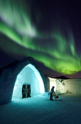 Ice Hotel in Sweden with Northern Lights Overhead