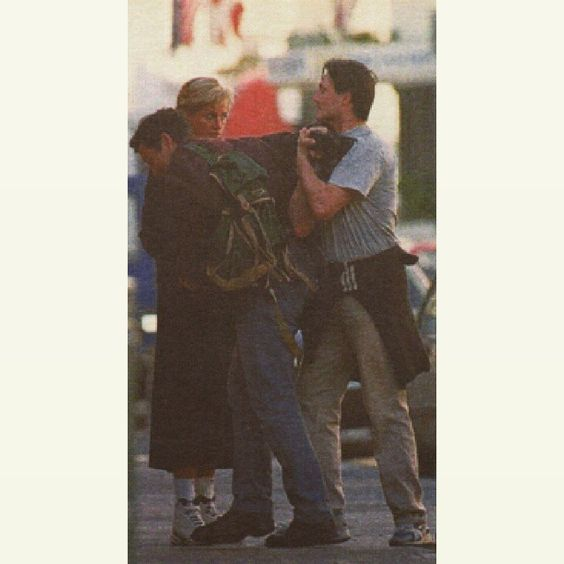 "In April 1997, a paparazzi took this rare picture of Diana looking stunned as a passer-by forced another freelance paparazzi into an armlock so that she could confiscate his film. Describing the incident, she said: ""It's a distressing intrusion into my private life."""