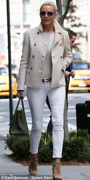 Love the matching beige peacoat and tee underneath, paired with slightly darker leather accessories.  The Hermes belt is a standout and the booties, plus large bag look ideal-very classic French with a twist!