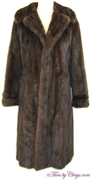 Mahogany Mink Coat MM803; $900; Excellent Condition; Size range: 4 - 8. This is a beautiful genuine natural mahogany mink fur coat. It has a Diamond Distinctive Designs label and features a large notched collar; straight sleeves that end in horizontal bands with a small slit and a decorative button; as well as a decorative back belt. The mink fur is very silky soft and shiny. This mahogany mink coat will keep you both warm and in the height of fashion! You will walk a little taller wearing…
