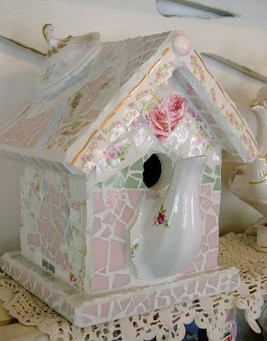 mosaic birdhouse with spout and lid