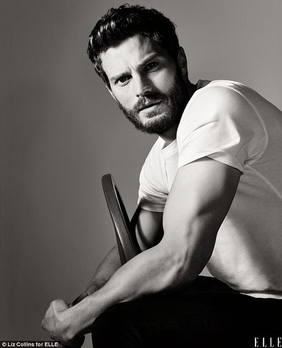 Smouldering: Jamie Dornan shows off his biceps in the February issue of Elle magazine as h...