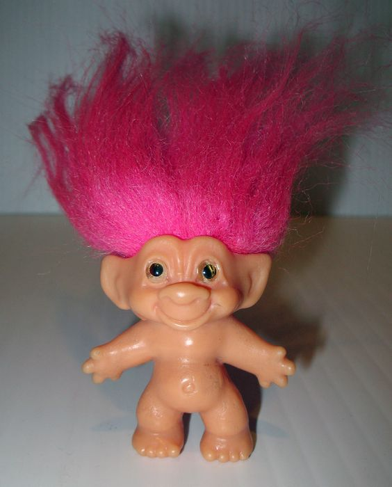 These were very popular when I grew up.  I played with a family of troll dolls and made them houses out of shoe boxes.