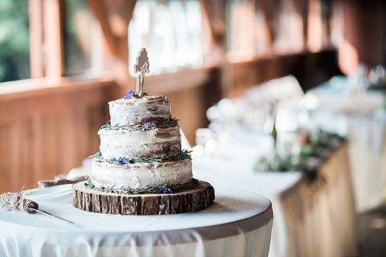 Wedding cake for rustic wedding - three-tier, semi-naked wedding cake with rosemary and tree slice cake stand {Kathryn Hyslop Photography}