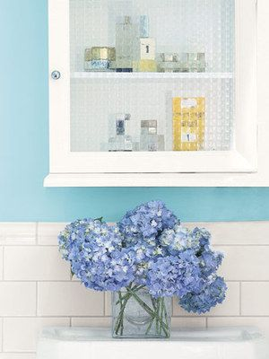Bursts of Color  Bring color into a bathroom not only through a bright wall hue, as seen here in this small space, but also through fresh flowers, like blue hydrangeas. They'll provide a pleasing pick-me-up every morning.    Read more: Blue and White Rooms - Decorating with Blue and White - Country Living