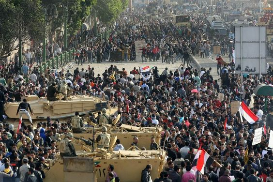 AFP - Getty Images  Facing off    Egyptian anti-government demonstrators, top, face pro-regime opponents, bottom, in Cairo's Tahrir Square on Feb. 2.