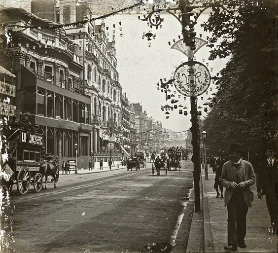 Walking down Piccadilly beside Green Park at the time of Victoria's Jubilee, 1897