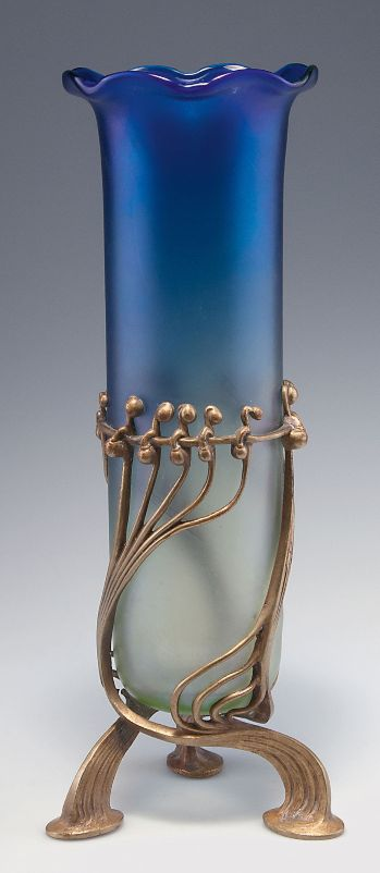 Loetz Wwe., Klostermühle. 'Luna' vase with bronze mounting by E. Bakalowits, 1901. H. 34 cm. Cased glass, slightly green/blue. Décor Luna optisch, slightly iridescent. | SOLD 2,800 EUR: