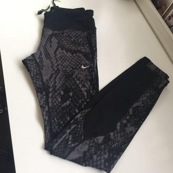 Nike Dri-Fit workout pants This fun snake print pair of Nike Dri-fit workout pants is brand new without tags. The material is high quality made to keep you warm. I'm hoarder when it comes to Nike workout clothes so make an offer and give these baby a new home. Nike Pants
