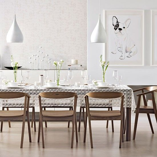 White dining room with walnut furniture A pared down backdrop, sleek furnishings and simple white accessories create a contemporary look in this dining room.