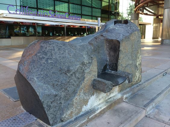 Stone seat. Has some polished areas. Entrance of california science center Los Angeles