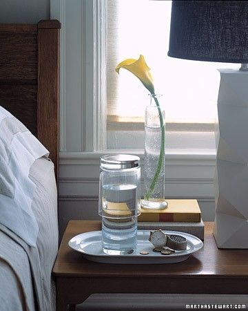 Bedside Water Glass - You don't need carafes and matching tumblers to provide overnight guests with water. Simply fill a tall, narrow glass, and cover it with a shorter, wider tumbler to keep out dust. Set the glasses on a small tray on the nightstand to catch any drips. Houseguests can flip over the top glass and pour themselves water or sip directly from the taller glass.