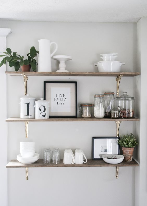 Open shelving in the kitchen is one of my favorite trends around. Here are 8 different ways to style and use open shelves in the kitchen - or any room!