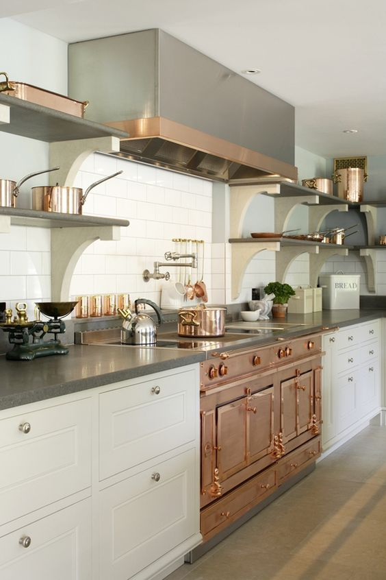 Kitchen Ideas: La Cornue stove. Just shy of copper, rose gold has a soft and sophisticated pink–like hue that flatters every design scheme.: